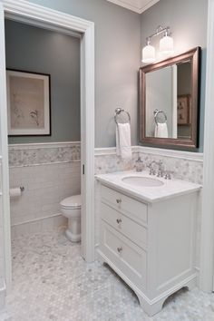 Traditional Master Bathroom with European Cabinets, Undermount sink, Inset cabinets, Crown molding, Simple marble counters