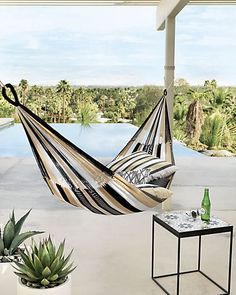 A CB2 exclusive. Designed in collaboration with Yellow Leaf, an organization with a focus on creating jobs and easing poverty, each hammock is 100% handwoven in Thailand by local artisans. Swing under the sun (or stars) in a breezy knit of black, white and natural weather-resistant/ fade-resistant yarn suspended from a swag of hand-knotted fringe. Each one-of-a-kind hammock comes tagged with the signature of its weaver.