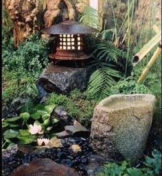 Japanese water garden w/ shishi odoshi, beautiful lantern -- I wish I could find this image again -- it's so peaceful