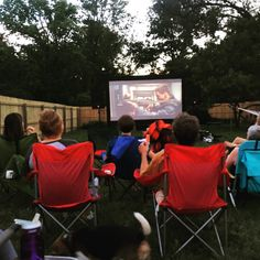 Now that our backyard is decent shape, we're hosting a movie night every Sunday for our friends and neighbors. Everyone comes by with chairs and beer and we provide the popsicles and popcorn. Backyard Chairs, Outdoor Chairs, Backyard Movie Nights, Family Movie Night, Popsicles, Popcorn, Bungalow, Sunday, Beer