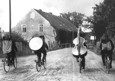 Folk musicians touring the European countryside by bicycle photo by Roger Viollet