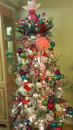 Hello Kitty Christmas tree 2013. This year I added larger Hello Kittys! I especially like the one from build build-a-bear dressed in Walmart Hello Kitty Christmas pajamas.