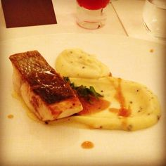 Pavé of line caught sea bass with black truffle mash and gravy sauce with sweet onions by Hélène Darroze