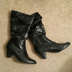 Black high heeled boots Great pair of black high heeled boots. Little scruff on heel shown in the second picture. Little wear on the front of the boots as shown in the last picture. Otherwise great condition! FIONI Clothing Shoes Heeled Boots