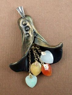 Elegant Lily Pendant with Polished Stones