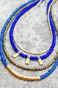 Inspired Long Blue Glass, Bronze and Gold Charm Necklace