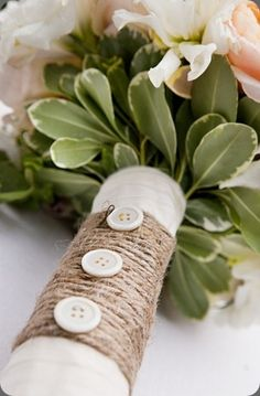 TOTALLY want this for wrapping my bouquet!!!!!! Perfect combo: string and buttons.