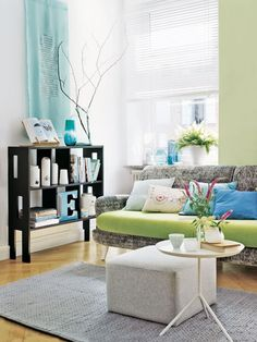 How fun! Love how the couch cushions pop against the rest of the sofa. Great colors! <3