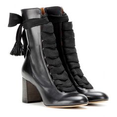 Chloé - Leather boots - These lace-up boots from Chloé just beg to be worn with fervently femme silhouettes. The smooth black leather design is laced up to the front with thick tonal ribbon. Finished with a round toe and chunky stacked heel, they're a sublime and worthy addition to any wardrobe. seen @ www.mytheresa.com