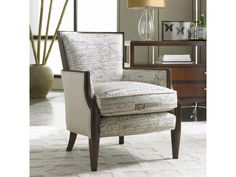 Accent your home with this Upholstered Exposed Wood Chair.  It features a dark wooden frame around the attached back, and the frame continues down to the tapered wooden legs.  The plush box seat cushion is encased in welt cord trim.  The clean lines and fluted tapered legs are well suited to modern or traditional settings. It is available in a variety of fabrics, colors, textures and even available in leather. Create a lovely accent in your living room, family room or bedroom with this…