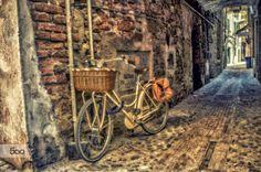 bicycle tied into an alley by gallogiancarlo on 500px