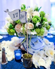 """See the """"Blue-and-White Centerpieces with Flags"""" in our Real Weddings with Blue Ideas gallery"""