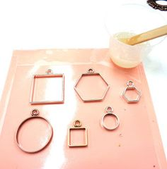 Frames placed on sticky contact for resin jewellery ideas.
