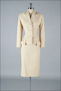 Vintage 1950s Suit . LILLI ANN . Oatmeal wool blend with silk crepe lining.  The pencil skirt is topped by a 'wow' jacket.  Classic Lilli Ann includes a button front closure, large lapel shawl-collar, nipped waist.  The hemline of the jacket is cut into an interesting squared petal design.  Long sleeves.