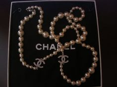 Chanel Timeless Pearl Necklace! I would cut someone for these babies.