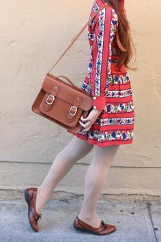 Brown satchel, loveky printed dress, stockings and tan shoes!