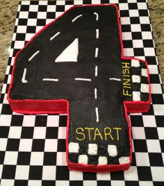 Cover cake board to look like racing flag. Use fondant?
