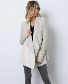 +A sweater cardigan with faux fur lined suede contrast front with draped lapels frame the open placket