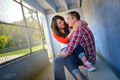 engagement photos, couples photography, couples poses, outift inspiration, baseball field engagement photos, softball field, all-star converse, chuck taylors, dugout, raglan tee, baseball tee