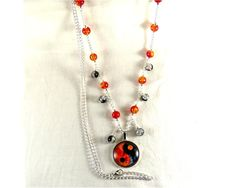 Long beaded necklace ,Yin Yang -Zen Attitude,silver tone chain , glass beads and glass cabochons by CapricesDeParisienne on Etsy
