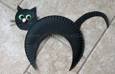 Cat! First cut crescent from a paper plate before painting. Add circular head. Attach pipe cleaners as whiskers, pompon ball as nose and paper ears, eyes, and tail.