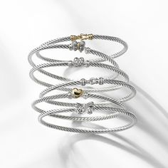Imagine an armful of David Yurman bracelets, layered to express your style. The Cable Collectibles® Collection.