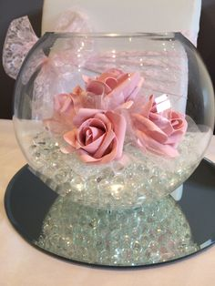 fish bowl wedding centrepiece with pink roses. Hire in South Wales from www.affinityeventdecorators.com