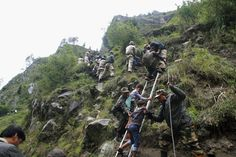 Indian army personnel rescue stranded children and other people to a safe place in the worst flood affected region of Govind Ghat, in the northern Indian state of Uttarakhand, on June 18, 2013 Posted by floodlist.com #Uttarakhand #Floods
