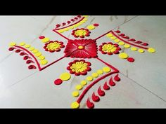 The purpose of rangoli is decoration, and it is thought to bring good luck. Rangoli is considered auspicious as it signifies showering of good luck and prosp. Rangoli Side Designs, Simple Rangoli Designs Images, Rangoli Designs Latest, Small Rangoli Design, Rangoli Patterns, Rangoli Ideas, Rangoli Designs Diwali, Rangoli Designs With Dots, Mehndi Art Designs
