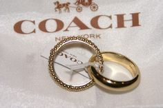 Coach Beaded Link Rings / Gold Tone / Size 8. Get the lowest price on Coach Beaded Link Rings / Gold Tone / Size 8 and other fabulous designer clothing and accessories! Shop Tradesy now