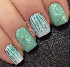 Sea foam green nails with silver glitter and white nails with blue and silver glitter lines.