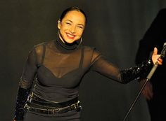 Sade kept her wardrobe changes simple, starting in black pants and sheer turtleneck and ending in an elegant white gown with a peekaboo red bra.