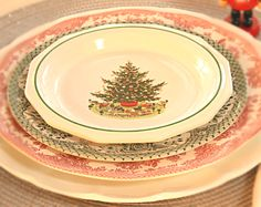 layer different vintage dishes in red and green for Christmas