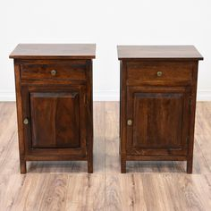 This pair of rustic nightstands are featured in a solid wood with a gorgeous dark cherry finish. These end tables are in great condition with 1 drawer, a large interior cabinet and carved panel trim. Simple bed side tables with tons of storage space! #rustic #dressers #nightstand #sandiegovintage #vintagefurniture