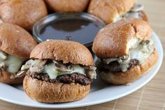 French Dip Burgers     ngredients:  2lbs ground beef  salt and pepper (to taste)  4 slices Swiss cheese (each slice cut into 4 squares)  1 package fresh sliced mushrooms  1 tablespoon garlic (minced)  2 tablespoons butter  12 slider buns  butter (for spreading)  Au Jus-  2 cups water  tablespoon better than bouillon beef base  2 teaspoons better than bouillon beef base  1/2 stalk celery  1/2 small onion  1 pinch thyme  salt and pepper (to taste)