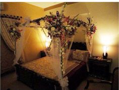 The bedroom is just one of the most sacred rooms of your house and you need to treat it like one. Floral arrangements are complete through local florists. Bridal Room Decor, Wedding Night Room Decorations, Indian Wedding Decorations, Indian Weddings, Bedroom Bed Design, Bedroom Decor, Wedding Bedroom, Wedding Bottles, Bedroom Night