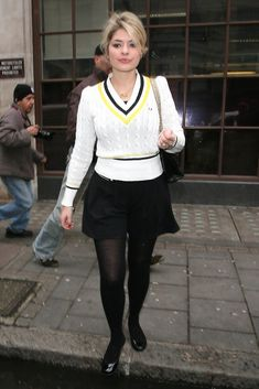 Holly Willoughby Photos - Holly Willoughby leaves BBC Radio one studios in London wearing a fashionable Fred Perry cricket-style sweater. - Holly Willoughby Leaves BBC Radio One Bad Girl Outfits, Cute School Uniforms, Holly Willoughby, Fashion Tights, Tv Presenters, Bbc Radio, Fred Perry, Covet Fashion, Cricket