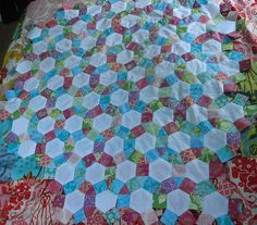 progress on my english paper piecing by amandasan, via Flickr