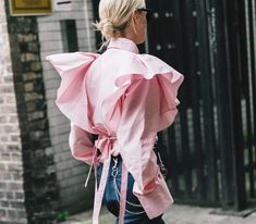 Photo via: Vogue Spain Thanks to this street style outfit, we've been on the hunt for the coolest pink statement tops of the moment. Think ruffles, flared sleeves, and other fun details. Get the look Fashion Week, Look Fashion, Fashion Details, Fashion Design, Fashion Trends, Street Fashion, Fashion Moda, Womens Fashion, Look Street Style