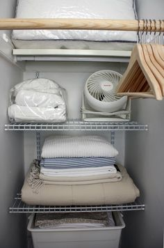 Good idea for a deep and narrow closet in a guest room. Marti & Jarrod's Graphic Modern Home