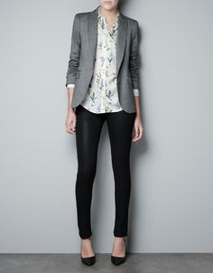 Grey blazer, floral button-up shirt, black trousers, black pumps -- work outfit