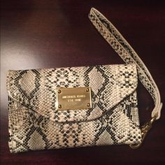 Iphone 4 Micheal Kors Wristlet MK wristlet! Only used like 5x because I upgraded my phone soon after I received it. LOOKS brand NEW. This fits the iphone 4 only. Beautiful snakeskin print wristlet in white, grey, and black. Inside has a slot for 3 cards and some cash, as well as an opening for your cell. Loves it ❤️ Michael Kors Bags Clutches & Wristlets