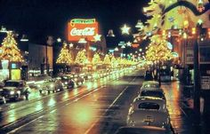 Christmas along Hollywood Boulevard sure looked festive back in the 1940s when this shot was taken, especially with those light-up Christmas trees that gave the street a golden glow. And that wet sheen on the road from a recent rainstorm gives it that cinematic look that night street scenes in movies always seem to have.