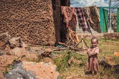 Cute little Ethiopian girl smiling in front of her mother's laundry. Addis Ababa, Arusha, Cute Little Things, Hey You, Ethiopia, Tanzania, Fine Art Photography, Laundry, Happiness