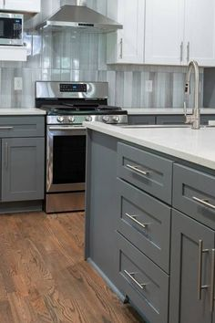 See how our designer Renae updates an Atlanta home to become a modern oasis. Grey Kitchen Designs, Kitchen Room Design, Kitchen Redo, Kitchen Remodel, Shaker Kitchen Cabinets, Kitchen Cabinet Styles, Kitchen Backsplash, Blue Kitchen Interior, Kitchen Upgrades