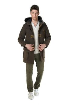 MJ.Classic coffee colored hooded peacoat perfect for the winter months. Features rustic toggle closure, deep pockets, and contrast piping. 60% Wool. 20% Poly. 15% Nylon. 5% Other Fibers.