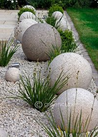 Concrete orbs to nestle in the gravel