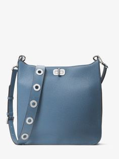 Classic leather takes the form of a messenger made current with a wide 9f18527757039