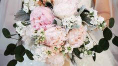 """Say """"I do"""" to these amazing arrangements. Peonies aren't just one of our favorite garden blooms ever – the lush flowers are also some of our all-time favorite fillers for beautiful wedding bouquets. Beloved for their sweet scent, bright color, and voluptuous blossoms, peonies are the picture-perfect addition to your bridal bouquet. Here are some of the prettiest peony bouquets, from bold and bright bridal flowers to subtle bridesmaid bouquets."""