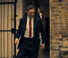 """Tom & Paul Anderson in the Brilliant movie """"Legend"""" sneaking away from Nipper (the cop who's out to get the Kray's) so they can go get Ron out of the nut house... Tom & Paul have acted together 3x that I know of- Legend, The Revenant & of course Peaky Blinders!"""